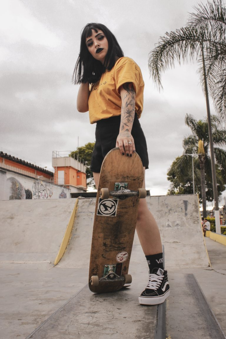 woman holding skateboard 3531535